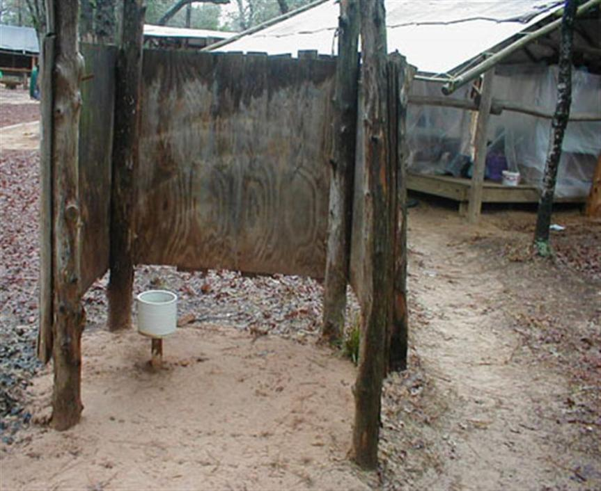 """""""Pee wall"""" next to sleeping quarters at therapeutic foster camp."""